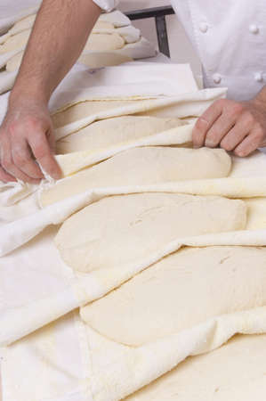 leavening: Baker kneads the flour on a shelf, to make bread