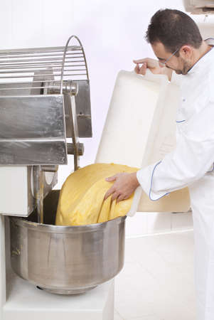 Pastry Chef pours ingredients into the mixer Banco de Imagens - 12881874