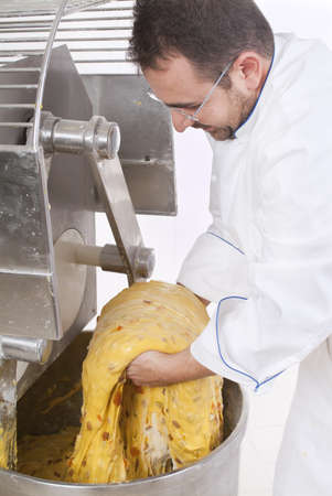 Pastry Chef, prepares dough to make the cake panettone Stock Photo