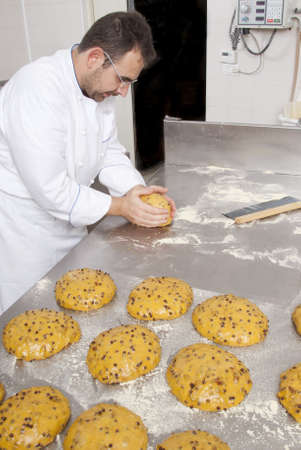 Pastry Chef, prepares dough to make the cake panettone Stok Fotoğraf