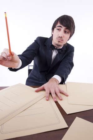 Businessman stressed in his office, many documents on the desk Stock Photo - 12961477