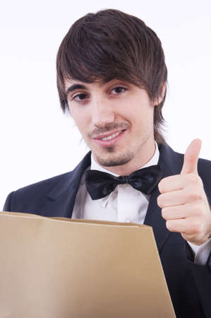 Stressed businessman makes faces and signs with his hands behind a folder photo