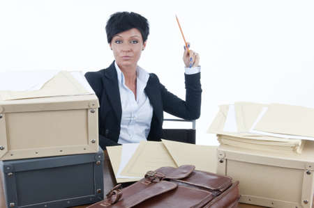 Stressed businesswoman sitting at her desk photo