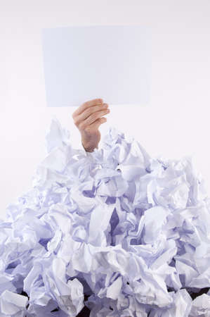 business problems: Businessman overwhelmed by the paper uses the language of signs Stock Photo
