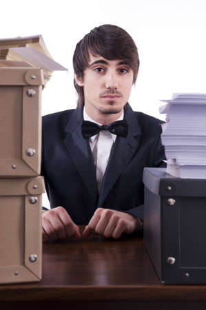 freak out: Businessman stressed in his office, many documents on the desk