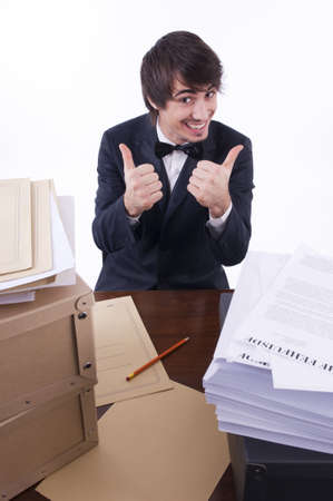 Businessman stressed in his office, many documents on the desk photo