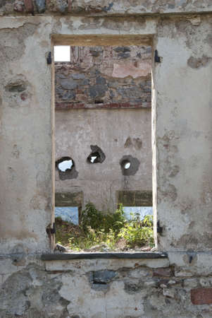 old concrete wall with windows in ruins photo