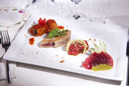 seared: prepared sea food Tuna ,Thorn, Salmon, decorated with vegetables