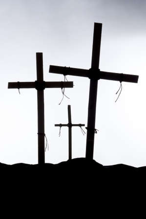 lent: Shadow and silhouette of the crucifixion on a white background