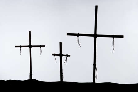 crucify: Shadow and silhouette of the crucifixion on a white background