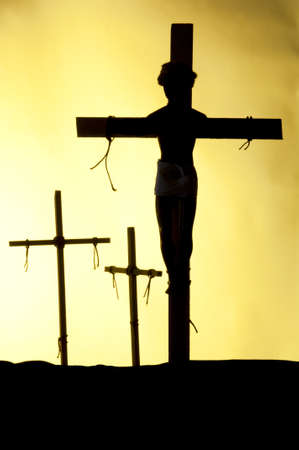 Shadow and silhouette of the crucifixion on a yellow background photo