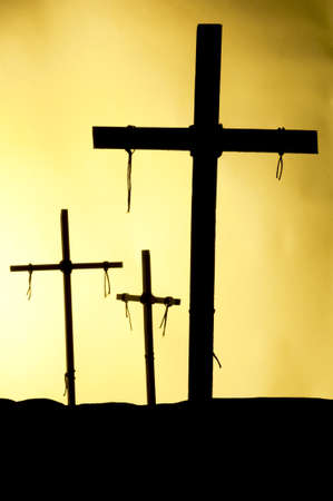 crucify: Shadow and silhouette of the crucifixion on a yellow background