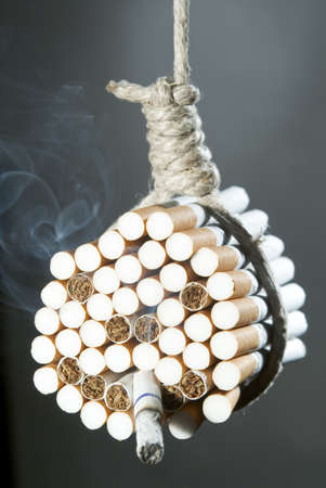 doped: A noose around a bunch of cigarettes that make a face with a cigarette in his mouth Stock Photo