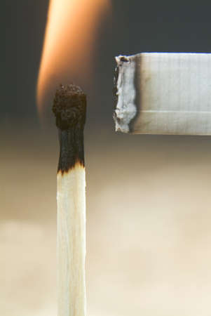 ashtray: fire to a cigarette with a match Stock Photo