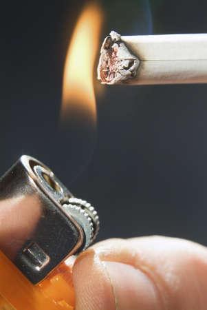 set fire to a cigarette with a lighter Banco de Imagens - 13151107