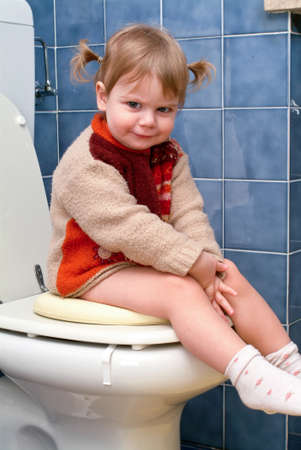 girl toilet: Little girl on the toilet that makes funny faces