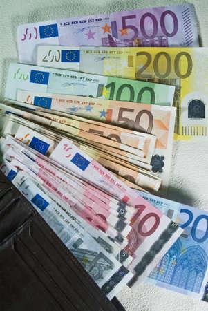 Wallet full of euro banknotes of various denominations photo