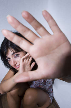 abuse young woman: Woman terrorized by a stalker is defending himself with her arms protects