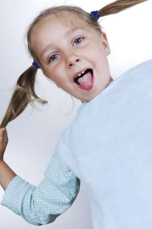 Girls in pajamas and pigtails out his tongue Stock Photo - 13235366