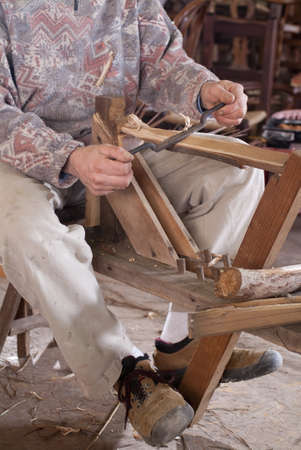 Carpenter cutting wood with the old blade tools photo