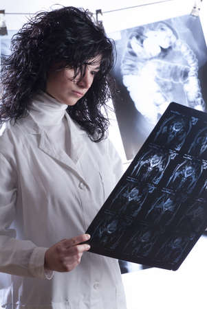 Doctors examining different radiographs in their study photo