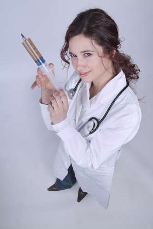 Doctor happy to get an injection seems crazy photo