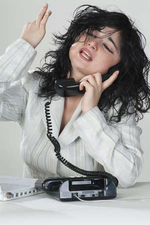 Business woman answers the phone with determination photo