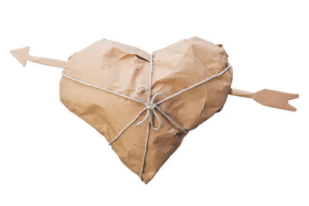 Shipping heart pierced by an arrow wrapped and tied with twine photo