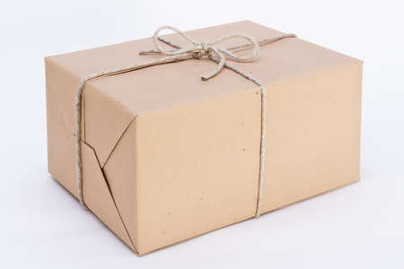 pack string: package ready for shipment, wrapped in brown paper and tied with twine Stock Photo