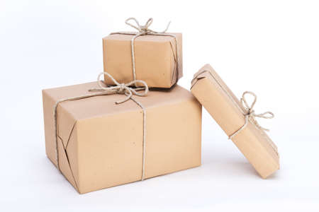 packages ready for shipment, wrapped in brown paper and tied with string Banco de Imagens - 16759878