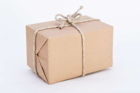 package ready for shipment, wrapped in brown paper and tied with twine Reklamní fotografie