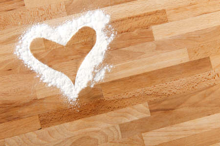 Heart shape on wood made with white flour Stock Photo - 16921931