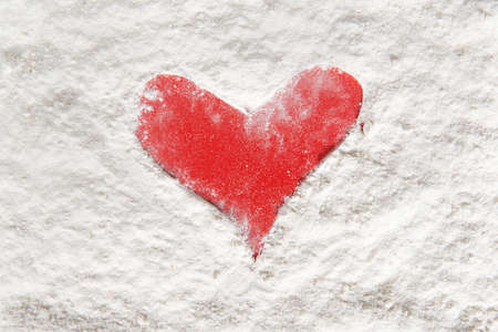 the form of a red heart made ​​with flour on wooden shelf Stock Photo - 16921907
