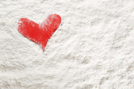 the form of a red heart made with flour on wooden shelf Stock Photo - 16921888