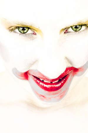 vindictive: artistic portrait of a little girl with face painted as a clown vindictive