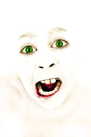 Artistic portrait of a girl with painted face shouting angrily photo