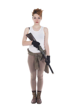 Studio shots of a young woman with rifle photo