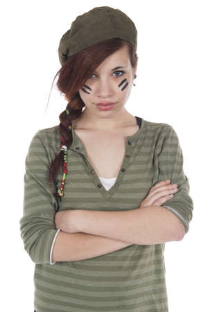 arrogant teen: Studio shots of a girl with arms crossed dressed as a mercenary