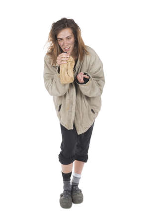 uncoordinated: shot in studio Young homeless alcoholic who laughs for the euphoria Stock Photo