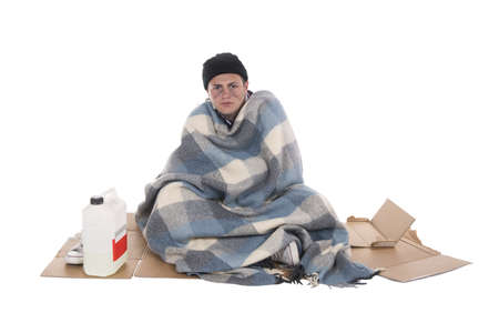 vagabond: Shooting in studio of a homeless person sitting on cardboard