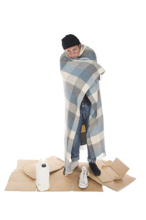 uncoordinated: Shooting in a studio Homeless wrapped in a blanket and standing on his board