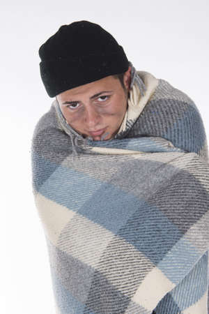 uncoordinated: Shooting in a studio Homeless wrapped in a blanket Stock Photo
