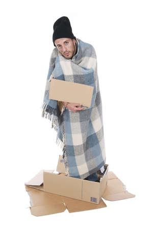 uncoordinated: Shooting in studio Homeless in his cardboard begging with a sign Stock Photo