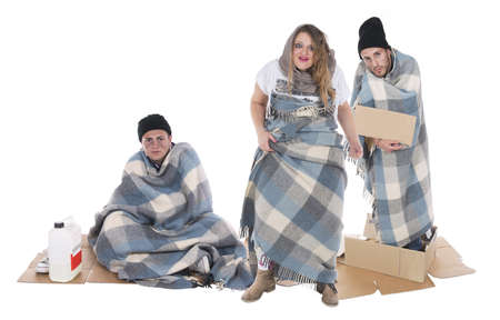 Shooting in studio to a family of gypsies begging, there is a very angry woman Stock Photo - 21001348