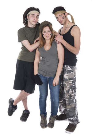 Studio shot three teenagers dressed as mercenary soldiers photo