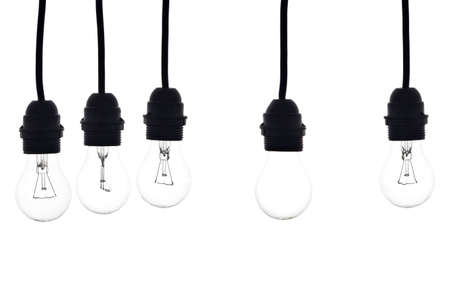 idea light bulb: bulbs hanging on white a white lamp separated from the other Stock Photo