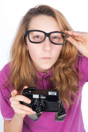Young photographer presumptuous, look holding glasses photo