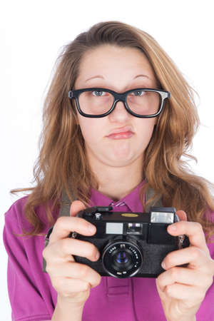 Young nerd photographer with camera in hand photo
