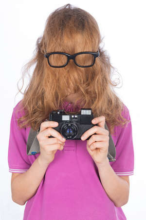 Young photographer like Hit cousin, his face covered with long hair photo