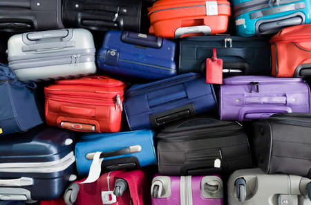 Suitcases multicolor stacked for transport one above the other